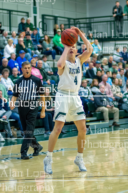 BLOOMINGTON, IL - January 04: Luke Yoder shoots the 3 during a college basketball game between the IWU Titans  and the Millikin Big Blue on January 04 2020 at Shirk Center in Bloomington, IL. (Photo by Alan Look)