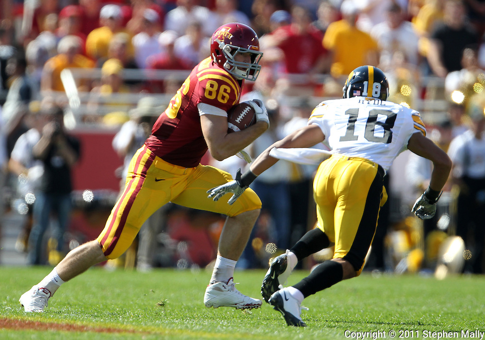 September 10, 2011: Iowa State Cyclones tight end Kurt Hammerschmidt (96) tries to avoid Iowa Hawkeyes cornerback Micah Hyde (18) after a catch during the first half of the game between the Iowa Hawkeyes and the Iowa State Cyclones during the Iowa Corn Growers Cy-Hawk game at Jack Trice Stadium in Ames, Iowa on Saturday, September 10, 2011. Iowa State defeated Iowa 44-41 in 3OT.