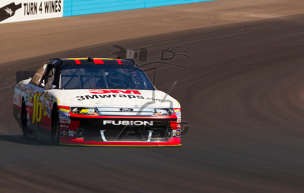 AVONDALE, AZ - MAR 03, 2012:  Greg Biffle (16) brings his NASCAR Sprint Cup car through turn 4 during qualifying for the Subway Fresh Fit 500 race at the Phoenix International Raceway in Avondale, AZ.
