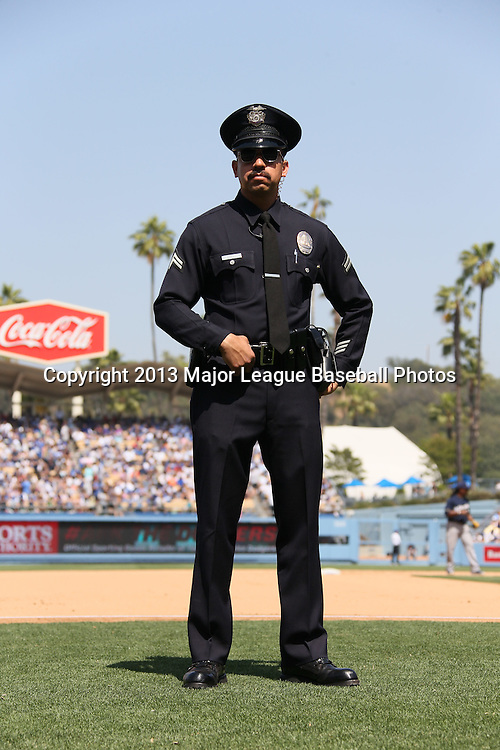 LOS ANGELES, CA - APRIL 28:  A policeman watches between innings during the Los Angeles Dodgers game against the Milwaukee Brewers on Sunday, April 28, 2013 at Dodger Stadium in Los Angeles, California. The Dodgers won the game 2-0. (Photo by Paul Spinelli/MLB Photos via Getty Images)