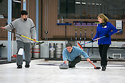 Richard Dimperio plays a shot as Tim Stames and Carol Della Villa assist during a match at Rochester Curling Club on Sunday, February 8, 2015.