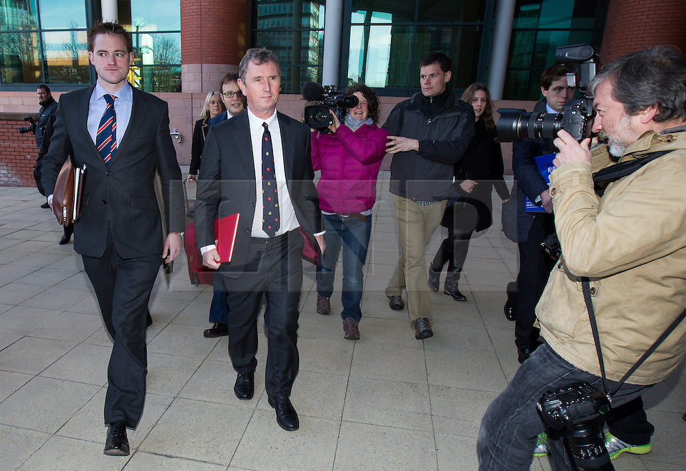 © Licensed to London News Pictures . 10/03/2014 . Preston , UK . The MP for Ribble Valley , NIGEL EVANS , arrives at Preston Crown Court this morning . Evans is charged with two counts of indecent assault , six counts of sexual assault and one count of rape , all of which he denies . Photo credit : Joel Goodman/LNP