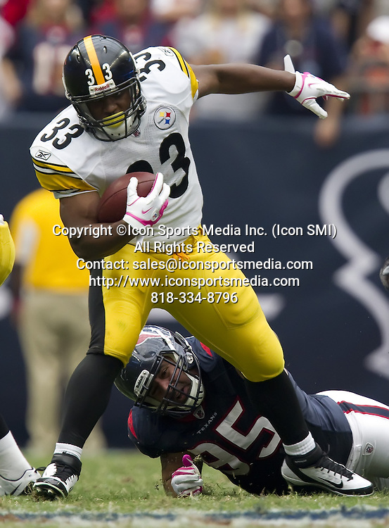 Oct. 2, 2011 - Houston, TX, USA - Isaac Redman (33) of the Pittsburgh Steelers escapes the tackle of  Shaun Cody (95) of the Houston Texans  in the second half of the Texans' 17-10 victory on Sunday, October 2, 2011, in Houston, Texas