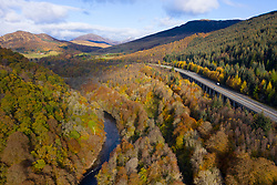 Transport corridor through the Pass of Killiecrankie in Perthshire, Scotland, UK. River Garry to left, mainline railway, B8079 and A9 to right.
