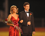 Senior maid Morgan Fyfe (left) is escorted by Johnny Graeber during Homecoming of the Oxford vs. Hernando in Oxford, Miss. on Friday, October 14, 2011. Hernando won 31-30 in overtime.