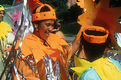 Performers dressed in colourful costumes taking part in street carnival,