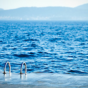 A ladder for leading down to the water for swimmers in Zadar, Croatia.<br />