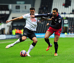Reading's Hal Robson-Kanu battles for the ball with Derby County's Cyrus Christie - Photo mandatory by-line: Alex James/JMP - Mobile: 07966 386802 - 14/02/2015 - SPORT - Football - Derby  - ipro stadium - Derby County v Reading - FA Cup - Fifth Round