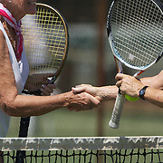 Jill Taylor, Australia and Susy Burggraf, Switzerland, shake hands after their match in the 65 Womens Singles during the 2009 ITF Super-Seniors World Team and Individual Championships at Perth, Western Australia, between 2-15th November, 2009.