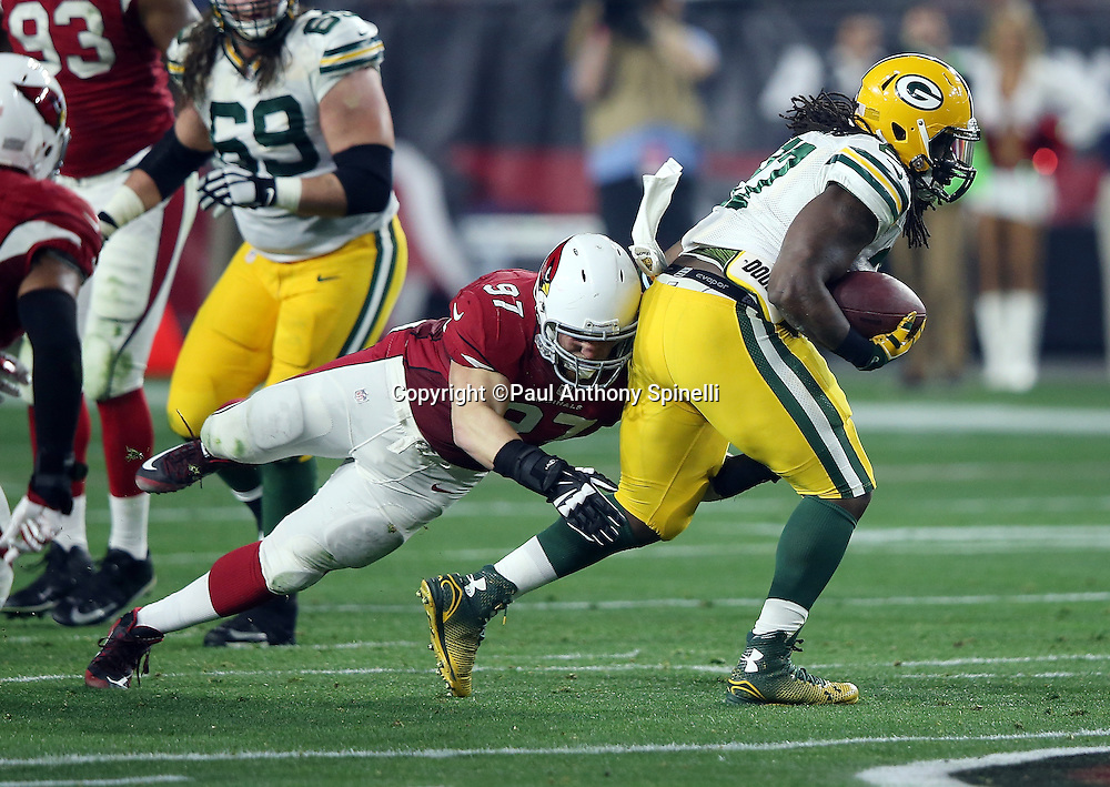 Green Bay Packers running back Eddie Lacy (27) gets tackled by Arizona Cardinals nose tackle Josh Mauro (97) as he runs the ball in the second quarter during the NFL NFC Divisional round playoff football game against the Arizona Cardinals on Saturday, Jan. 16, 2016 in Glendale, Ariz. The Cardinals won the game in overtime 26-20. (©Paul Anthony Spinelli)
