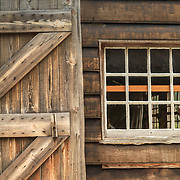 A wood door and window on a building at the Williamsburg historic complex.