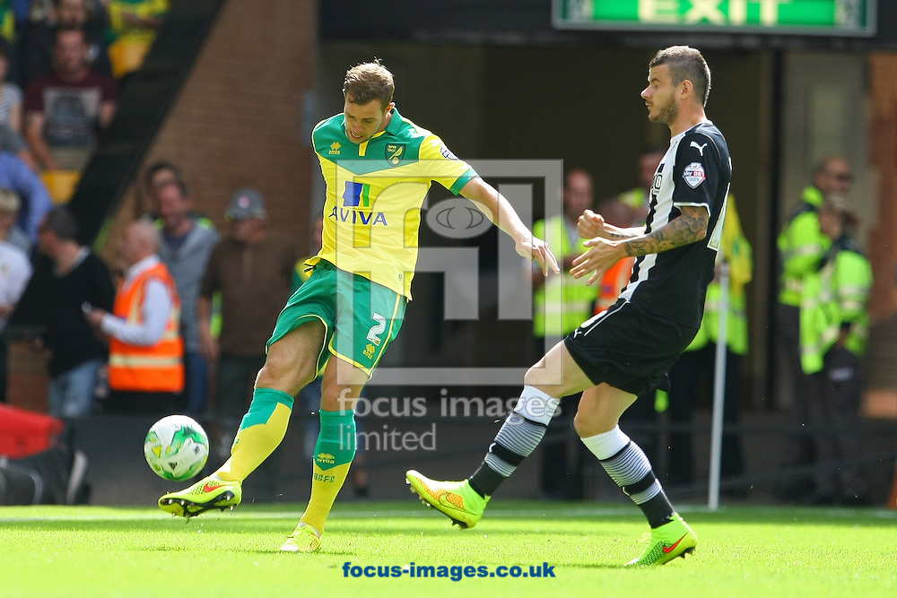 Steven Whittaker of Norwich and D&aacute;niel Tőzs&eacute;r of Watford in action during the Sky Bet Championship match at Carrow Road, Norwich<br /> Picture by Paul Chesterton/Focus Images Ltd +44 7904 640267<br /> 16/08/2014