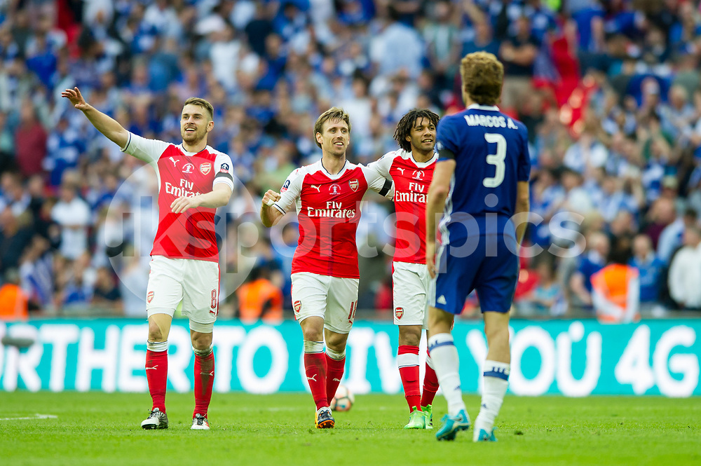 Aaron Ramsey of Arsenal Nacho Monreal of Arsenal celebrates the victory of the FA Cup during the Emirates FA Cup Final between Arsenal and Chelsea at Wembley Stadium, London, England on the 27th May 2017. Photo by Salvio Calabrese.