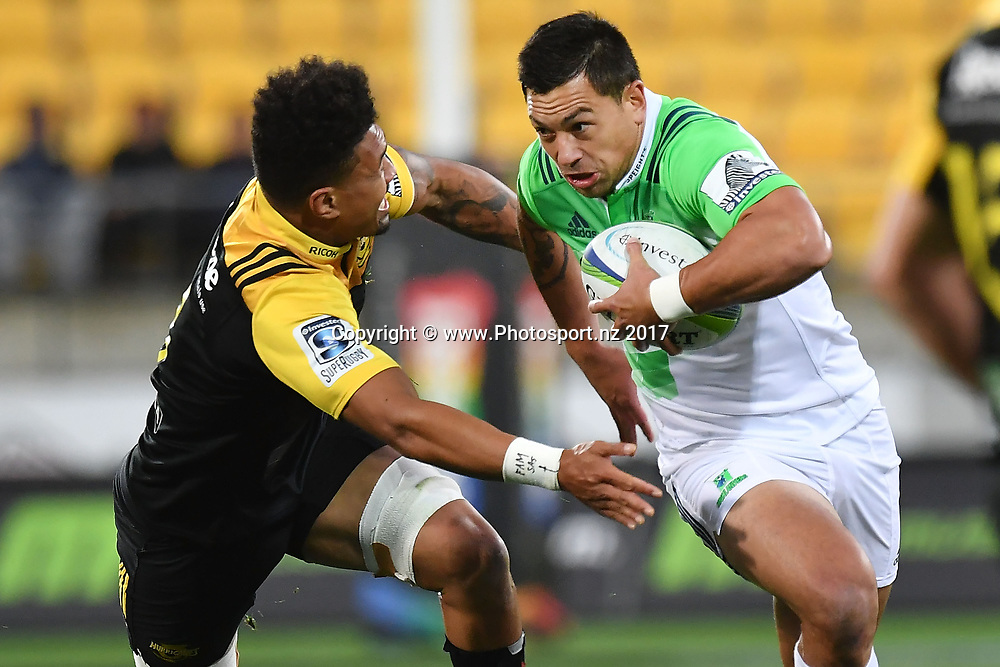 Highlanders' Rob Thompson (R is tackled by Hurricanes' Ardie Savea during the Hurricanes vs Highlanders Super Rugby match at Westpac Stadium in Wellington on Saturday the 18th of March 2017. Copyright Photo by Marty Melville / www.Photosport.nz