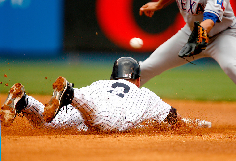 NEW YORK - MAY 10: Derek Jeter #2 of the New York Yankees slides into second against the Texas Rangers on May 10, 2007 at Yankee Stadium in the Bronx borough of New York City.