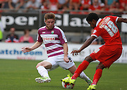 Barnet defender, Elliott Johnson looks to tackle Bradley Pritchard during the Sky Bet League 2 match between Leyton Orient and Barnet at the Matchroom Stadium, London, England on 8 August 2015. Photo by Bennett Dean.