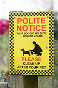 Polite notice your dog did his duty now do yours, Please clean up after your pet, Suffolk, England, UK