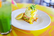 Dill & Chive soft scrambled eggs with smoked salmon, hollandaise, avocado, lemon on a crispy hash brown and Green Juice - Apple, spinach, cucumber.
