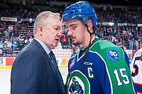 REGINA, SK - MAY 23: Regina Pats' head coach John Paddock speaks to Glenn Gawdin #15 of the Swift Current Broncos at the end of his last WHL game at the Brandt Centre on May 23, 2018 in Regina, Canada. (Photo by Marissa Baecker/CHL Images)