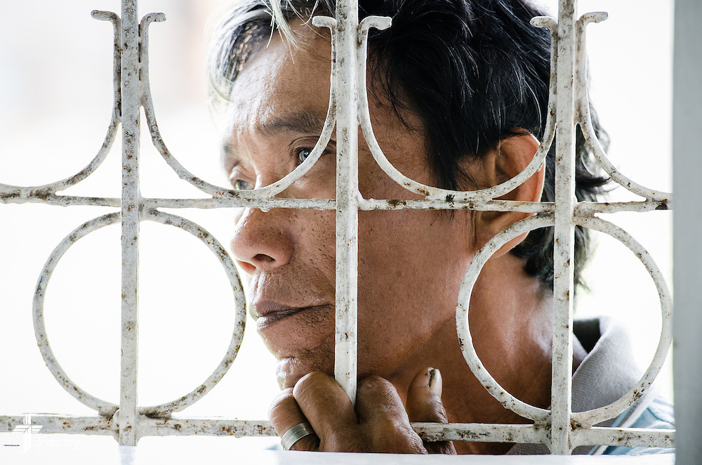 A man watches from the window during worship at Christ Lutheran Church in Mahayag, Leyte Province, Philippines, on Sunday, March 16, 2014. LCMS Communications/Erik M. Lunsford
