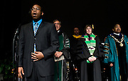 Student Vocalist Michael Ward performs the National Anthem during the Founders Day Convocation on Friday, February 15, 2008 in the Baker Ballroom in Athens, Ohio. photo by Kevin Riddell