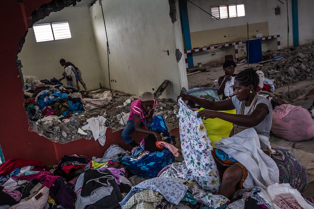DAJABÓN, DOMINICAN REPUBLIC - JUNE 26, 2015:  Haitian women sell second-hand clothes at the binational frontier market zone in the Dominican Republic.  Twice a week, the border is opened up so that people can pass freely to go to work, or buy and sell at the market without registering with border officials. PHOTO: Meridith Kohut for The New York Times