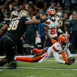 Sep 16, 2018; New Orleans, LA, USA; Cleveland Browns quarterback Tyrod Taylor (5) dives on a loose ball as New Orleans Saints defensive tackle Sheldon Rankins (98) pursues during the fourth quarter of a game at the Mercedes-Benz Superdome. The Saints defeated the Browns 21-18. Mandatory Credit: Derick E. Hingle-USA TODAY Sports