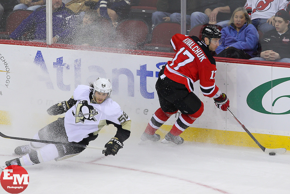 Apr 25, 2013; Newark, NJ, USA; New Jersey Devils right wing Ilya Kovalchuk (17) avoids Pittsburgh Penguins defenseman Kris Letang (58) during the third period at the Prudential Center.  The Devils defeated the Penguins 3-2.