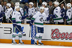 January 3, 2011; San Jose, CA, USA;  Vancouver Canucks left wing Daniel Sedin (22) celebrates with teammates after scoring a goal against the San Jose Sharks during the first period at HP Pavilion. Mandatory Credit: Jason O. Watson / US PRESSWIRE
