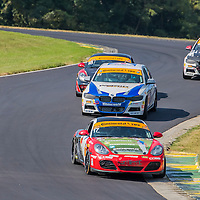 Alton, VA - Aug 26, 2016:  The RS1 Logistics Porsche Cayman races through the turns at the Oak Tree Grand Prix at Virginia International Raceway in Alton, VA.
