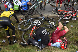 March 23, 2018 - Harelbeke, BELGIUM - Belgian Stijn Steels of Sport Vlaanderen - Baloise, French Yohann Gene of Direct Energie and Austrian Marco Haller of Katusha-Alpecin sit by the side of the road, after a fall during the 61st edition of the 'E3 Prijs Vlaanderen Harelbeke' cycling race, 206,5 km from and to Harelbeke, Friday 23 March 2018. BELGA PHOTO DIRK WAEM (Credit Image: © Dirk Waem/Belga via ZUMA Press)