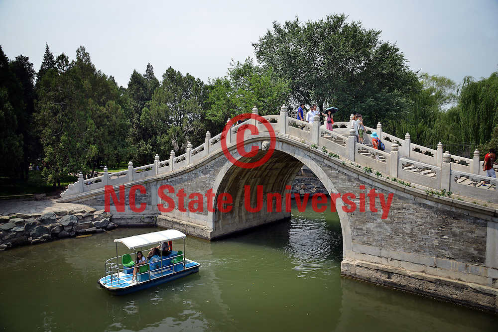 Tourists take in the Summer Palace outside Beijing.