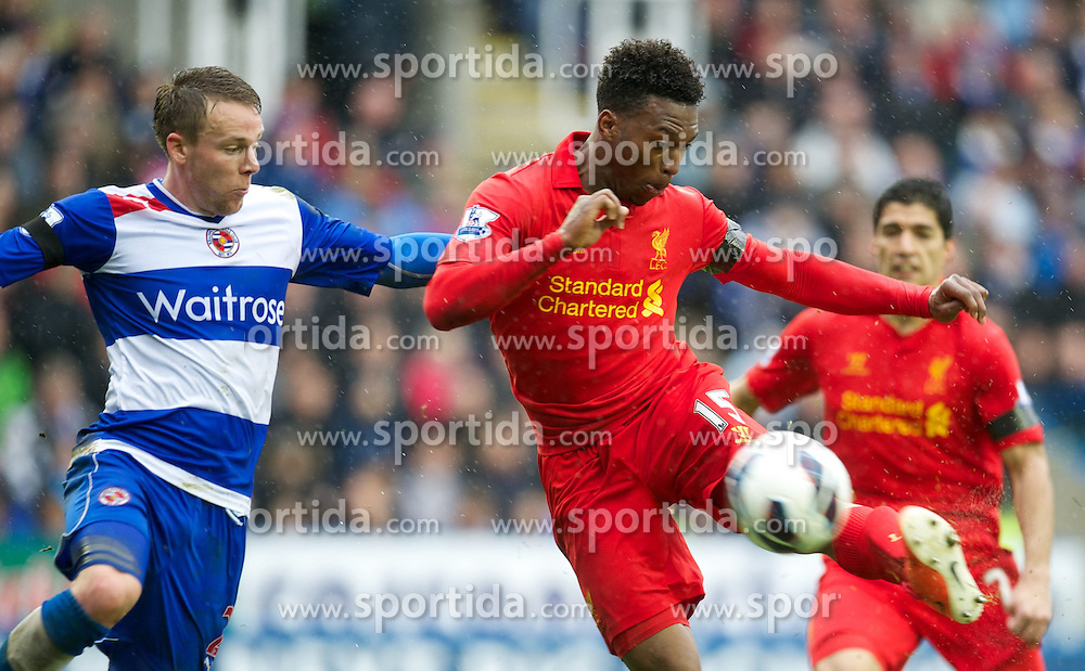 13.04.2013, Madejski Stadion, Reading, ENG, Premier League, FC Reading vs FC Liverpool, 33. Runde, im Bild Liverpool's Daniel Sturridge in action against Reading's Chris Gunter during during the English Premier League 33th round match between Reading FC and Liverpool FC at the Madejski Stadium, Reading, Great Britain on 2013/04/13. EXPA Pictures © 2013, PhotoCredit: EXPA/ Propagandaphoto/ David Rawcliffe..***** ATTENTION - OUT OF ENG, GBR, UK *****