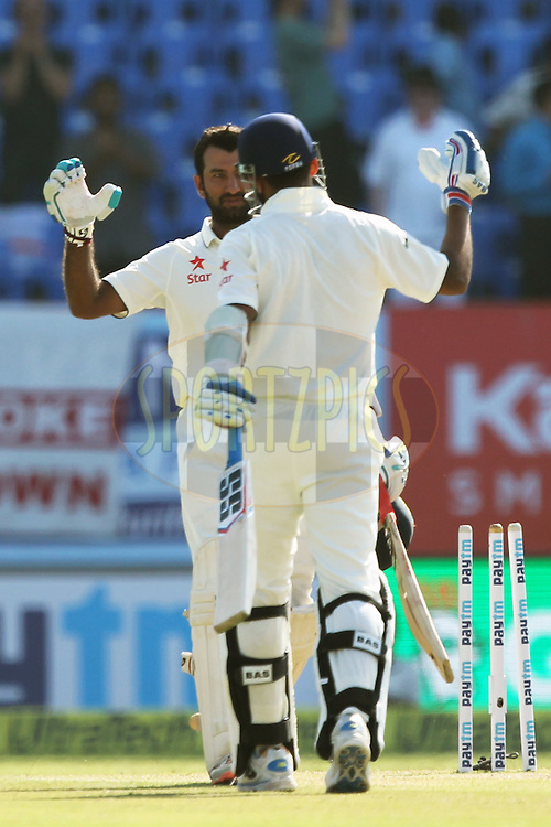 Cheteshwar Pujara of India celebrates his century during day 3 of the first test match between India and England held at the Saurashtra Cricket Association Stadium , Rajkot on the 11th November 2016.Photo by: Prashant Bhoot/ BCCI/ SPORTZPICS
