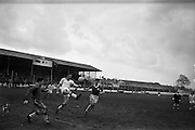 20/03/1963<br /> 03/20/1963<br /> 20 March 1963<br /> Soccer: Transport v Limerick, Cup tie replay at Harold's Cross, Dublin. Transport defender, Williams, gets his foot to the ball to clear as limericks O'Brien (right) runs in. On left is Transport keeper Grogan.