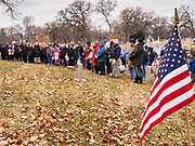 14 DECEMBER 2019 - DES MOINES, IOWA: Volunteers during the Pledge of Allegiance before they went out to lay Christmas wreaths on the veterans' graves in Woodland Cemetery. Volunteers working with Wreaths Across America placed Christmas wreaths on the headstones of more than 600 US military veterans in Woodland Cemetery in Des Moines. The cemetery, one of the first in Des Moines, has the graves of veterans going back to the War of 1812.     PHOTO BY JACK KURTZ