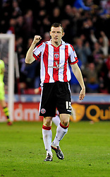 Sheffield United's Neil Collins celebrates the opening g - Photo mandatory by-line: Dougie Allward/JMP - Tel: Mobile: 07966 386802 03/05/2013 - SPORT - FOOTBALL - Bramall Lane - Sheffield - Sheffield United V Yeovil Town - NPOWER LEAGUE ONE PLAY-OFF SEMI-FINAL FIRST LEG