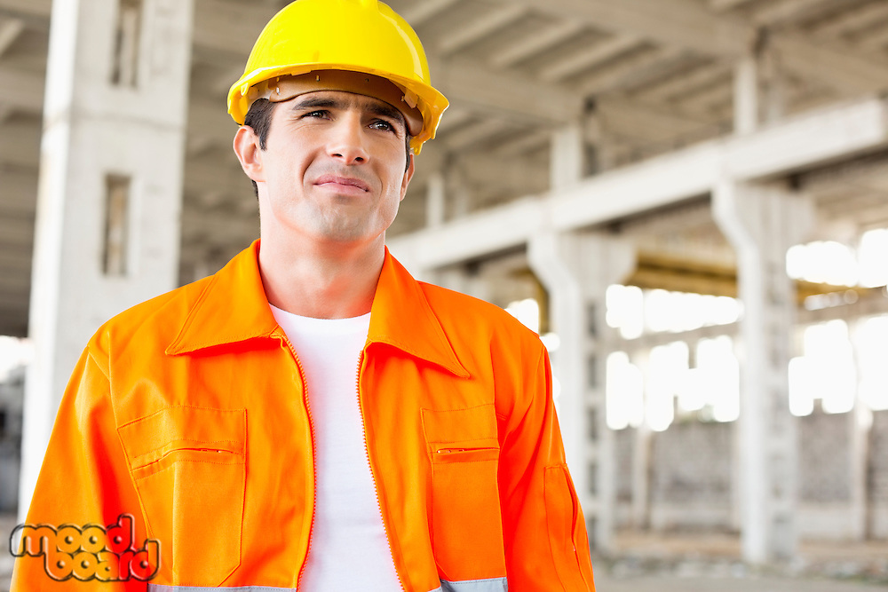 Handsome mid adult man wearing protective workwear at construction site