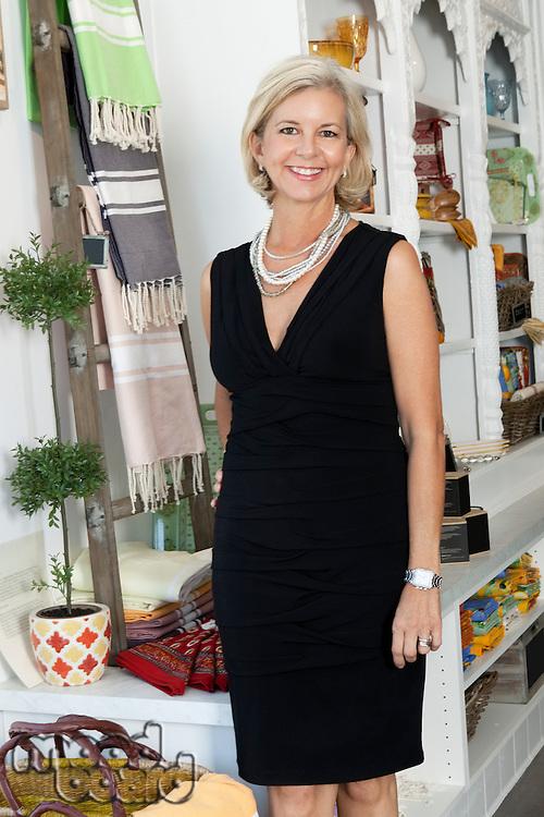 Portrait of mature female shop owner smiling