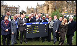 Pete Waterman, record producer and songwriter (middle), with High Speed Rail supporters and MP's as they hold a High Speed Rail Arrivals card outside the House of commons in favour of the announcement  today that Phase one of high-speed rail line gets go-ahead, Tuesday January 10, 2012. Photo By Andrew Parsons/ i-Images