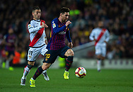 Leo Messi drives the ball pursued by Embarba of Rayo Vallecano (left) during the Spanish league football match of 'La Liga'  FC BARCELONA against RAYO VALLECANO at Camp Nou Stadium of Barcelona on March 9,2019