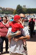 ANAHEIM, CA - JUNE 16:  A father carries his son into the stadium before the Los Angeles Angels of Anaheim game against the New York Yankees on Sunday, June 16, 2013 at Angel Stadium in Anaheim, California. The Yankees won the game 6-5. (Photo by Paul Spinelli/MLB Photos via Getty Images)