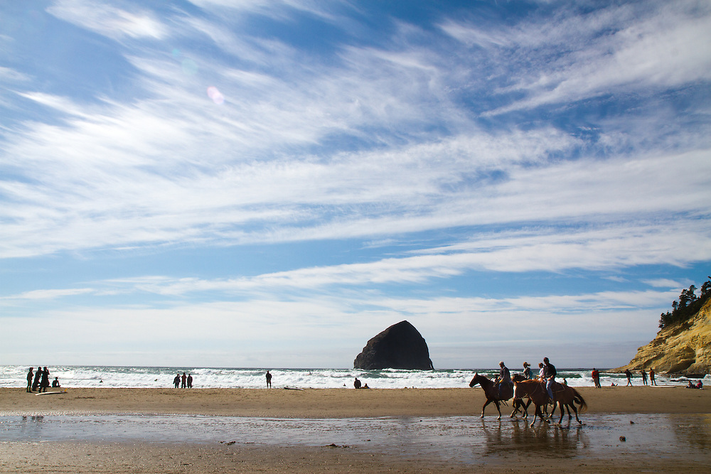 Horseback riding on the beach at Pacific City Oregon with Haystack Rock in the background. The Oregon Coast, a classic, beautiful road trip. Heading West from Portland to Tillamook, with a detour to the fishing village of Garibaldi, through Cape Lookout State Park and on to our final destination of Pacific City.