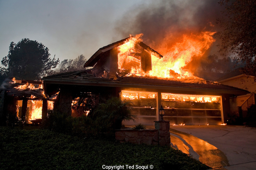 A house burns completely down in the hills of Yorba Linda..Wild fire burns in the community of Yorba Linda