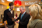 Repro Free: 20/01/2012.The Minister for Jobs, Enterprise and Innovation, Richard Bruton TD is pictured test driving the Repro Free: 20/01/2013.Locker13 MyPad at the opening Showcase 2013, showcasing the best of fashion and homewear from leading Irish designers this week at Ireland's largest international trade fair with Karen Hennesy, Chief Executive, Crafts Council of Ireland. Showcase takes place at the RDS from Sunday 20th to Wednesday 23rd January. For more information visit www.showcase .com. Picture Andres Poveda