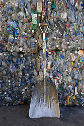 Stanford Recycling center. Compacted plastic bottles and shovel.