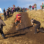 A competitor dressed as Animal from The Muppets in action during the New Zealand Cyclocross Championships sponsored by AJ Hackett Bungy, held at Jardine Park,  Queenstown, as part of the Queenstown WInter Festival. The men's event was won by Dan Warren from Hastings while Anja McDonald from Dunedin won the women's event. Queenstown, New Zealand, 2nd July 2011