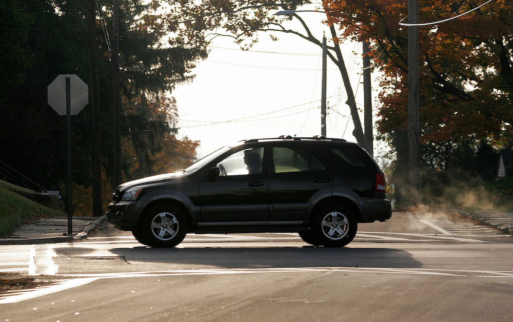 Middletown, N.Y. - An SUV drives down Highland Avenue shortly after dawn on Oct. 31, 2007.