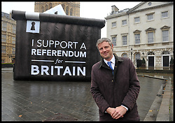 Conservative MP Zac Goldsmith pose's  for a photograph in front of a Ballot box with a I Support A  Referendum for Britain slogan on it in Westminster, London, United Kingdom. Wednesday, 6th November 2013. Picture by Andrew Parsons / i-Images