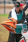 Stephen Ames caddy shakes his umbrella before the final round of the Rolex Senior Golf Open at St Andrews, West Sands, Scotland on 29 July 2018. Picture by Malcolm Mackenzie.